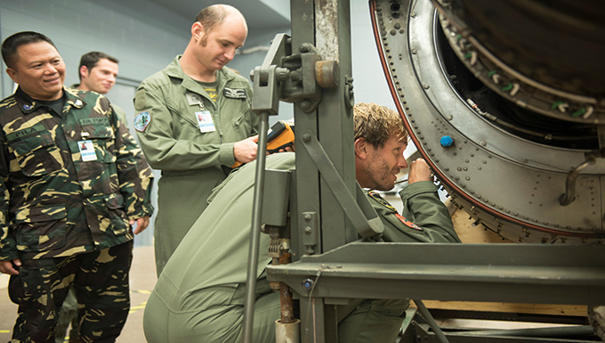 International service members learn with Cannon maintainers